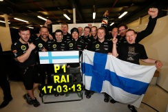 Kimi Raikkonen, Lotus F1, 1st position, celebrates with his team.