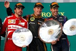 Kimi Raikkonen, Lotus F1, 1st position, on the podium with Fernando Alonso, Ferrari, 2nd position, and Sebastian Vettel, Red Bull Racing, 3rd position.