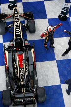 Kimi Raikkonen, Lotus F1, 1st position, celebrates victory in Parc Ferme.