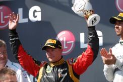 Kimi Raikkonen, Lotus F1, celebrates on the podium