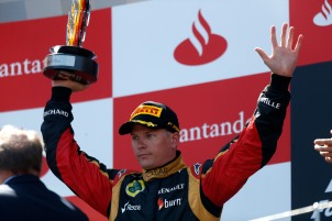 Kimi Raikkonen, Lotus F1, 2nd position, wih his trophy on the podium