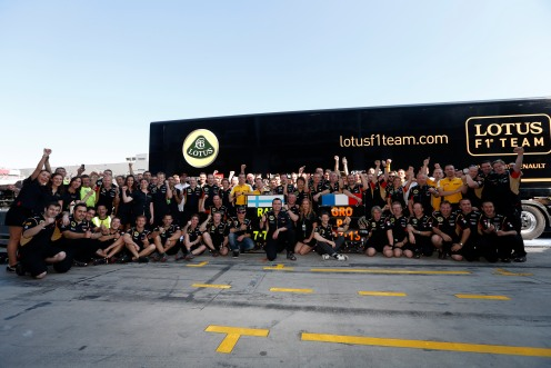 The Lotus F1 team celebrate a double podium finish