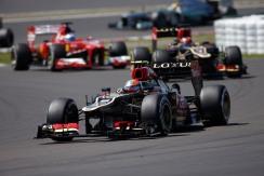Romain Grosjean, Lotus E21 Renault, leads Kimi Raikkonen