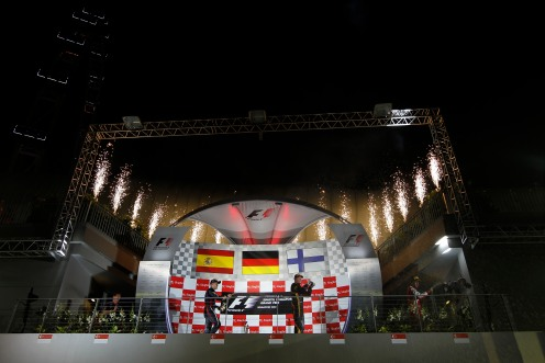 Kimi Raikkonen, Lotus F1 celebrates on the podium.