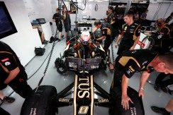 Romain Grosjean, climbs into his Lotus E21 Renault.