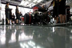 The Lotus team wait to release Kimi Raikkonen,