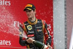 Romain Grosjean, Lotus F1, 3rd position, sprays Champagne on the podium.
