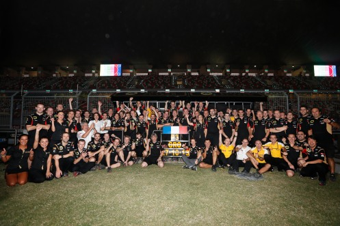 The Lotus Renault F1 team celebrate Romain Grosjean's podium