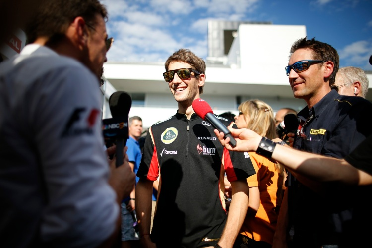Romain Grosjean, Lotus F1, talks to the media.