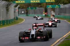 Romain Grosjean, Lotus E22 Renault, leads Max Chilton, Marussia MR03