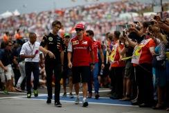 Romain Grosjean, Lotus F1, with Fernando Alonso, Ferrari, in the drivers parade.